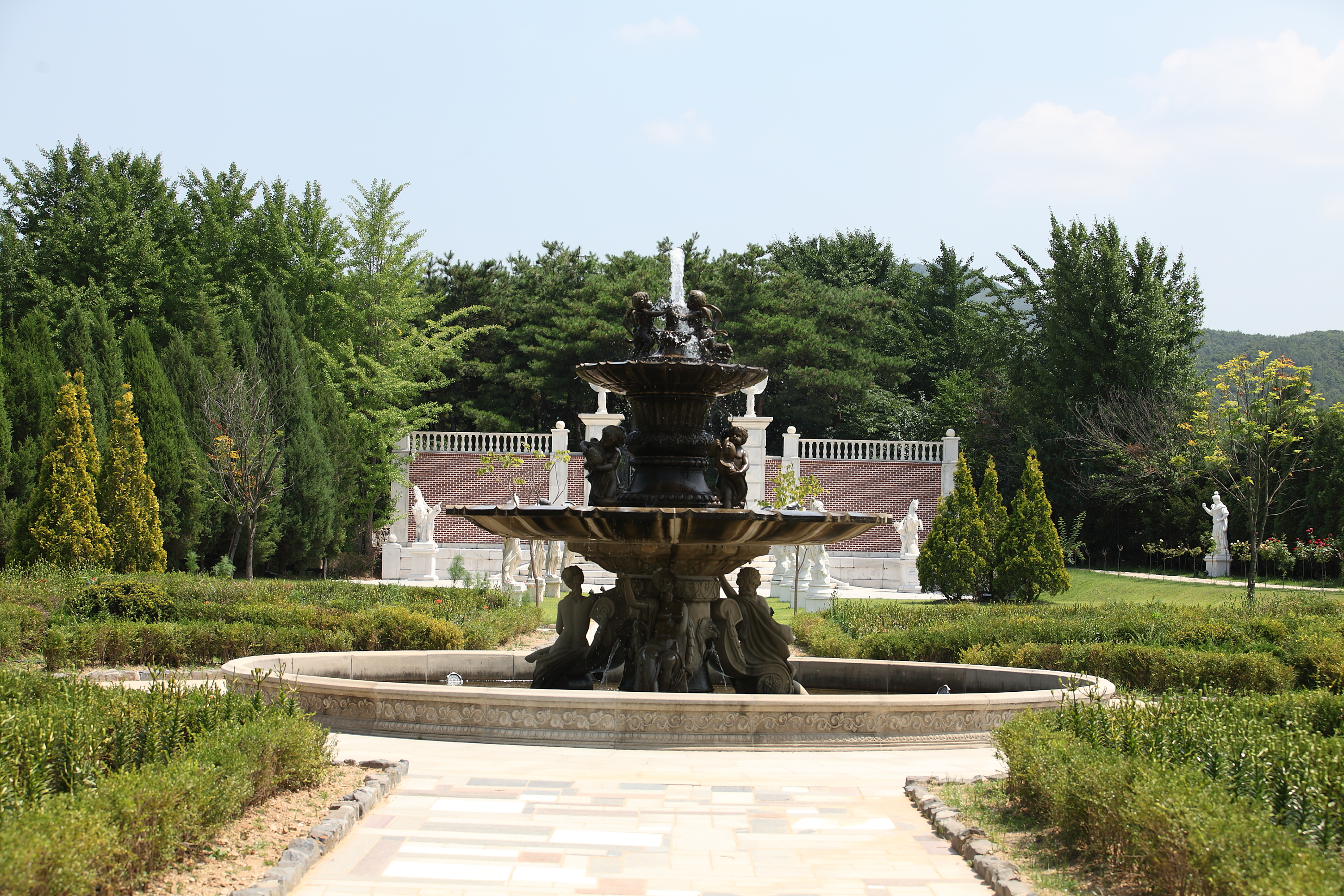 A front view of the central fountain of Byeokchojimunhwa Arboretum. It's 2-stroy fountain and decorated with baby angels.
